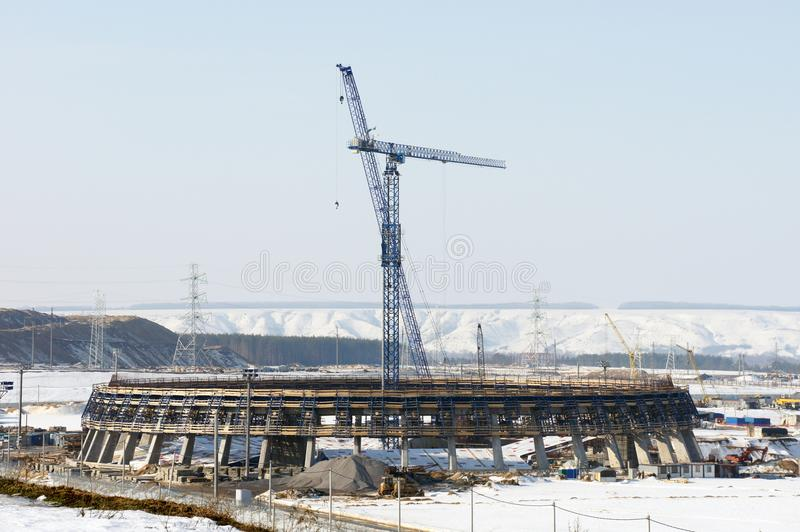 Winter urban industrial landscape. Construction engineering project with cranes. Winter building work. Urban industrial landscape royalty free stock images