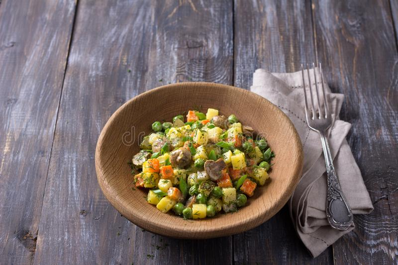 Winter vegetable vegetarian salad with mushrooms, russian salad, with homemade mayonnaise royalty free stock images