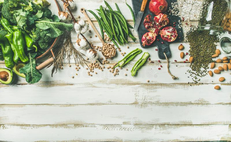 Winter vegetarian food cooking ingredients, white painted wooden background stock images
