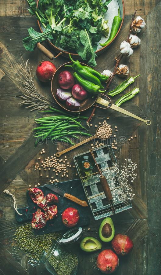 Winter vegetarian or vegan food cooking ingredients, vertical composition. Winter vegetarian food cooking ingredients. Flat-lay of seasonal vegetables and fruit royalty free stock photography