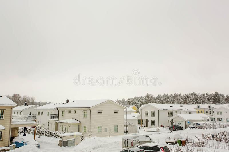 Winter view of country village with white houses covered with snow. Beautiful landscape background. stock photos