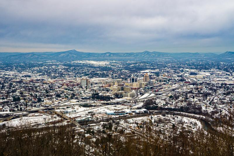 A Winter View of Downtown Roanoke with the Mountains in the Background. A winter view of downtown Roanoke Valley a winter storm with the Blue Ridge Mountains in royalty free stock images