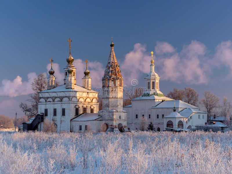 Winter view of the ensemble of ancient orthodox churches in Dymkovo Sloboda, Veliky Ustyug, Vologodsky region, Russia. Winter view of the ensemble of ancient stock photos