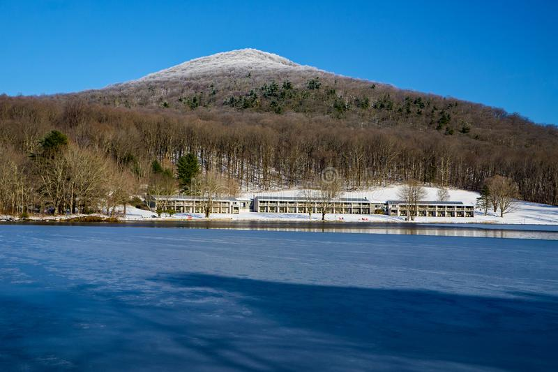 Winter View of Frozen Abbott Lake, Peaks of Otter Lodge and Flat Top Mountain stock photo