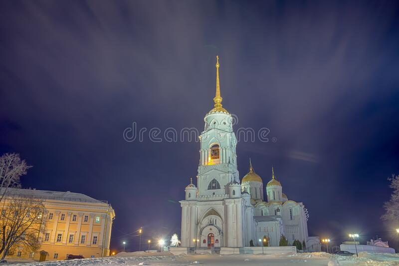Winter view of the Holy Dormition Cathedral in the city of the Golden ring Vladimir. Winter view of the Holy Dormition Cathedral in the evening in the city of stock photo