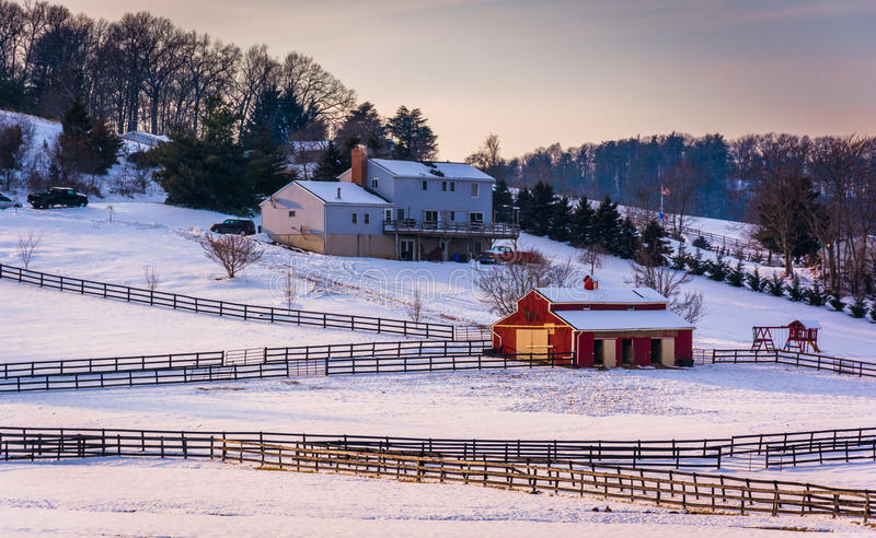 Winter view of a house and barn on farm in rural Carroll County, Maryland. stock photography