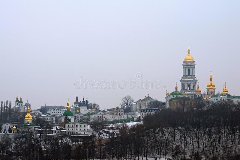 Winter view of Kyievo-Pechers`ka lavra and Belltower on blue sky background. It is a historic Orthodox Christian monastery. Morning landscape photo. Kyiv stock image
