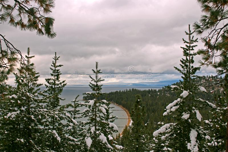 Peekaboo view of South Lake Tahoe Pier from Round Hill stock images