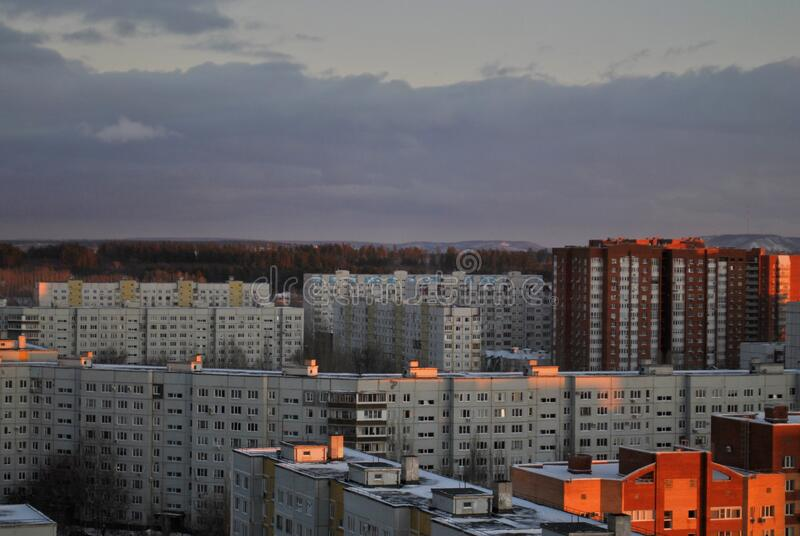 Winter view of new residential district in the city of Togliatti against the backdrop of a beautiful sunset sky and clouds. Winter view of new residential stock photos
