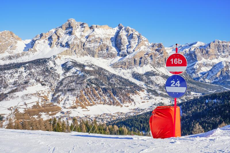 Winter view of Piz dles Cunturines Cima Cunturines from a ski slope in Alta Badia, South Tyrol, Dolomiti mountains, Italy. With piste signs for red and blue royalty free stock photos