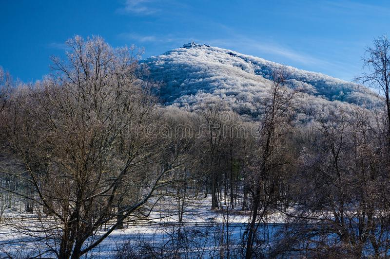 Winter View of Sharp Top Mountain. Bedford County, VA – January 15th:Winter view of Sharp Top Mountain located at the Peaks of Otter located in Bedford royalty free stock photo