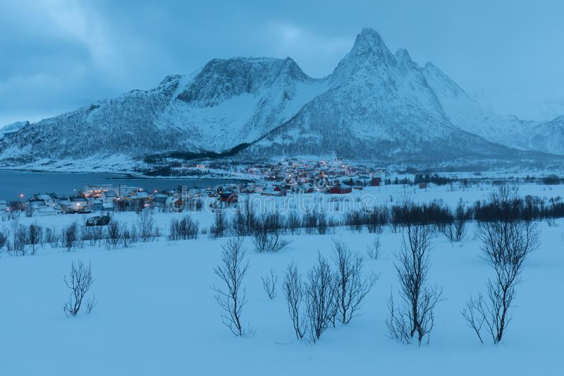 Winter view to Mefjord on Senja island. Cloudy dusk or night in Mountains And Fjords, Winter Landscape, fishing village, Norway stock photography