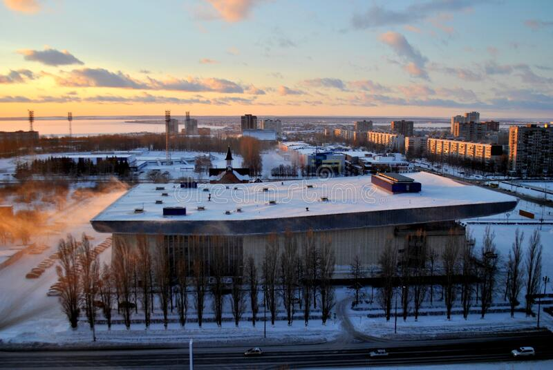 Winter view of the Volgar Sports Palace in the city of Togliatti against a stunningly beautiful sunset sky and clouds. Winter view of the Volgar Sports Palace royalty free stock photo