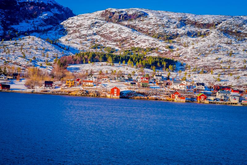 Winter views of wooden houses a long in the coast from Hurtigruten voyage, Northern Norway.  stock photo