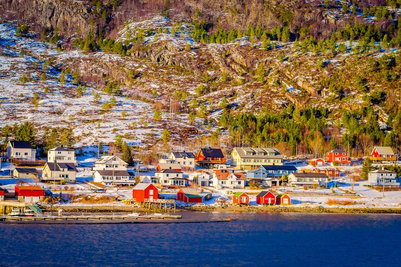 Winter views of wooden houses a long in the coast from Hurtigruten voyage, Northern Norway.  royalty free stock photo