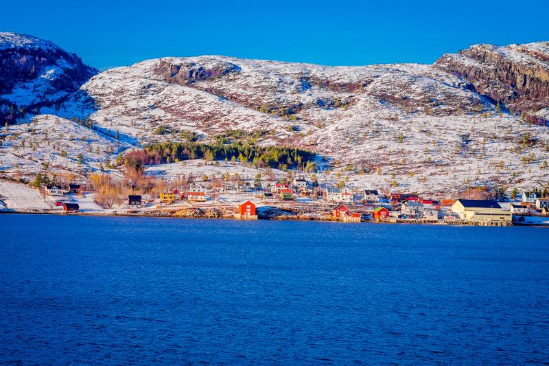 Winter views of wooden houses a long in the coast from Hurtigruten voyage, Northern Norway.  stock photos