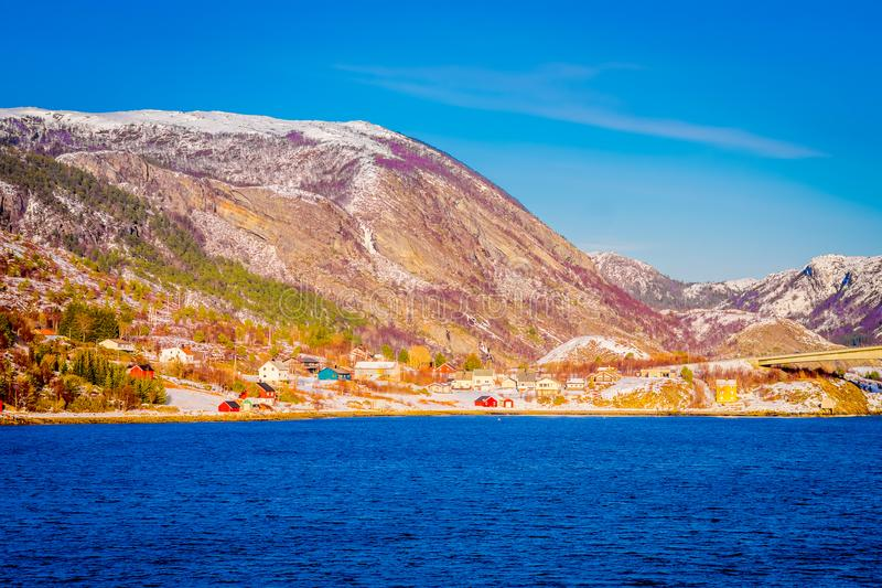 Winter views of wooden houses a long in the coast from Hurtigruten voyage, Northern Norway.  royalty free stock image