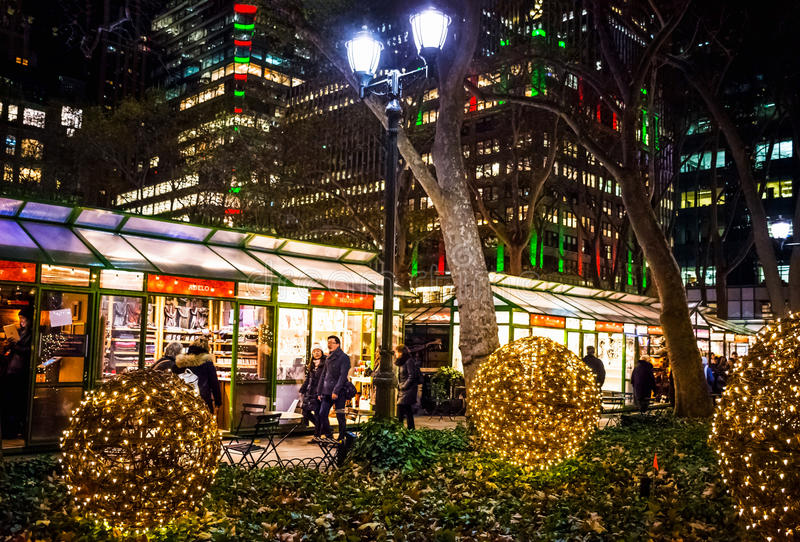 Winter Village Bryant Park. NEW YORK-DECEMBER 14: Holiday shoppers enjoy the scene of the Winter Village at Bryant Park on December 14, 2016 in Manhattan royalty free stock photo