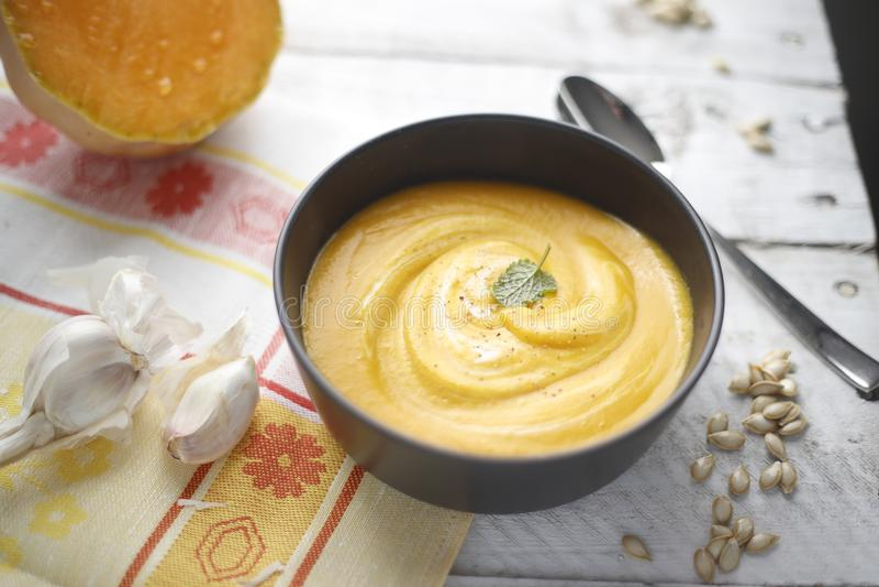 Winter warming homemade organic pumpkin soup stock photo