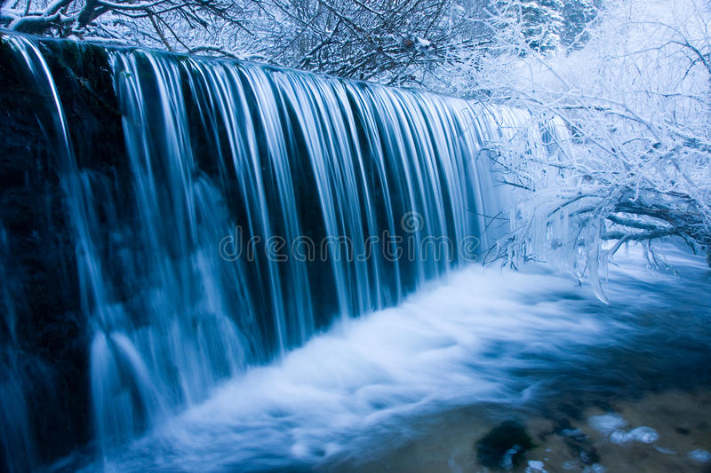 Winter Waterfall. Spray frosts all around it stock photography