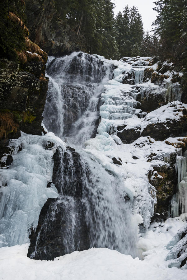 Winter waterfall. In the Alps mountains stock image