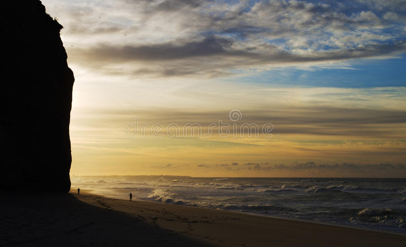 Winter waves against the sunset royalty free stock image