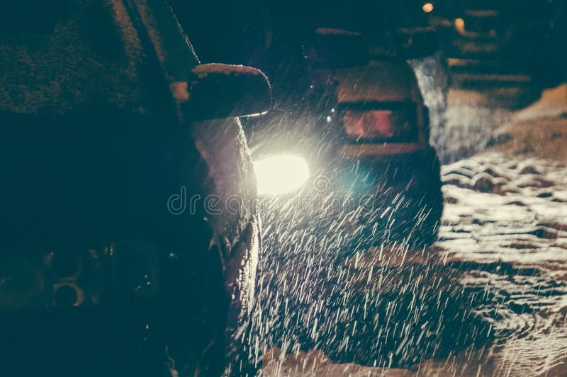 Snowstorm in the city. Cars traveling through the snow on a city street stock images