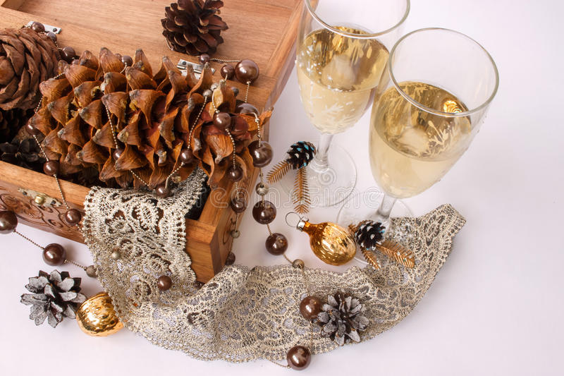 Winter wedding glasses with champagne and pine cones. Winter wedding champagne glasses and pine cones on ribbon with lace royalty free stock image