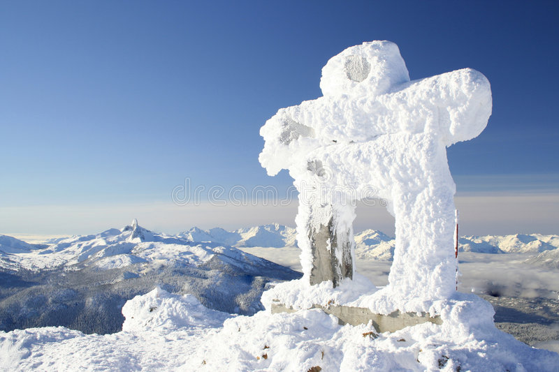Winter Welcome. A snow covered Inuksuk greets visitors to the Whistler valley, site of the 2010 Olympics stock image