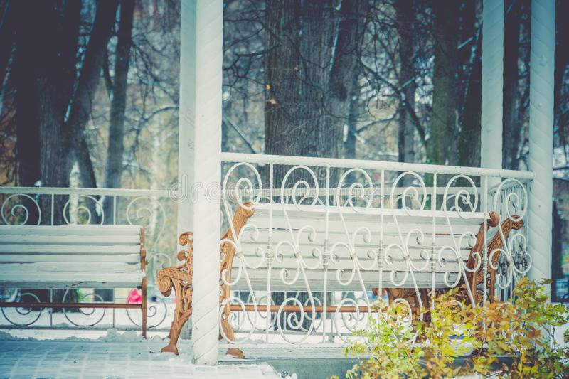 Winter White Alcove. Decorative wooden alcove with benches in the city park at the winter time royalty free stock photo