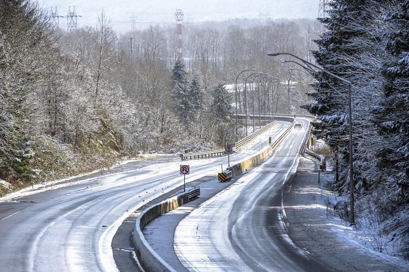 Winter winding snowy divided road to Colombia River Gorge stock image