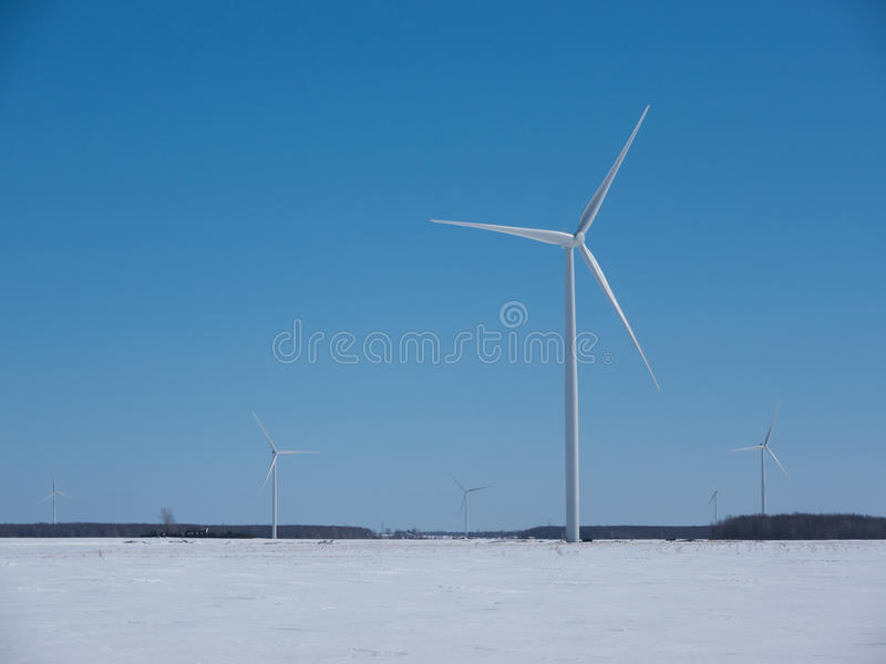Winter Windmills. Large windmills in a snowy winter field stock images