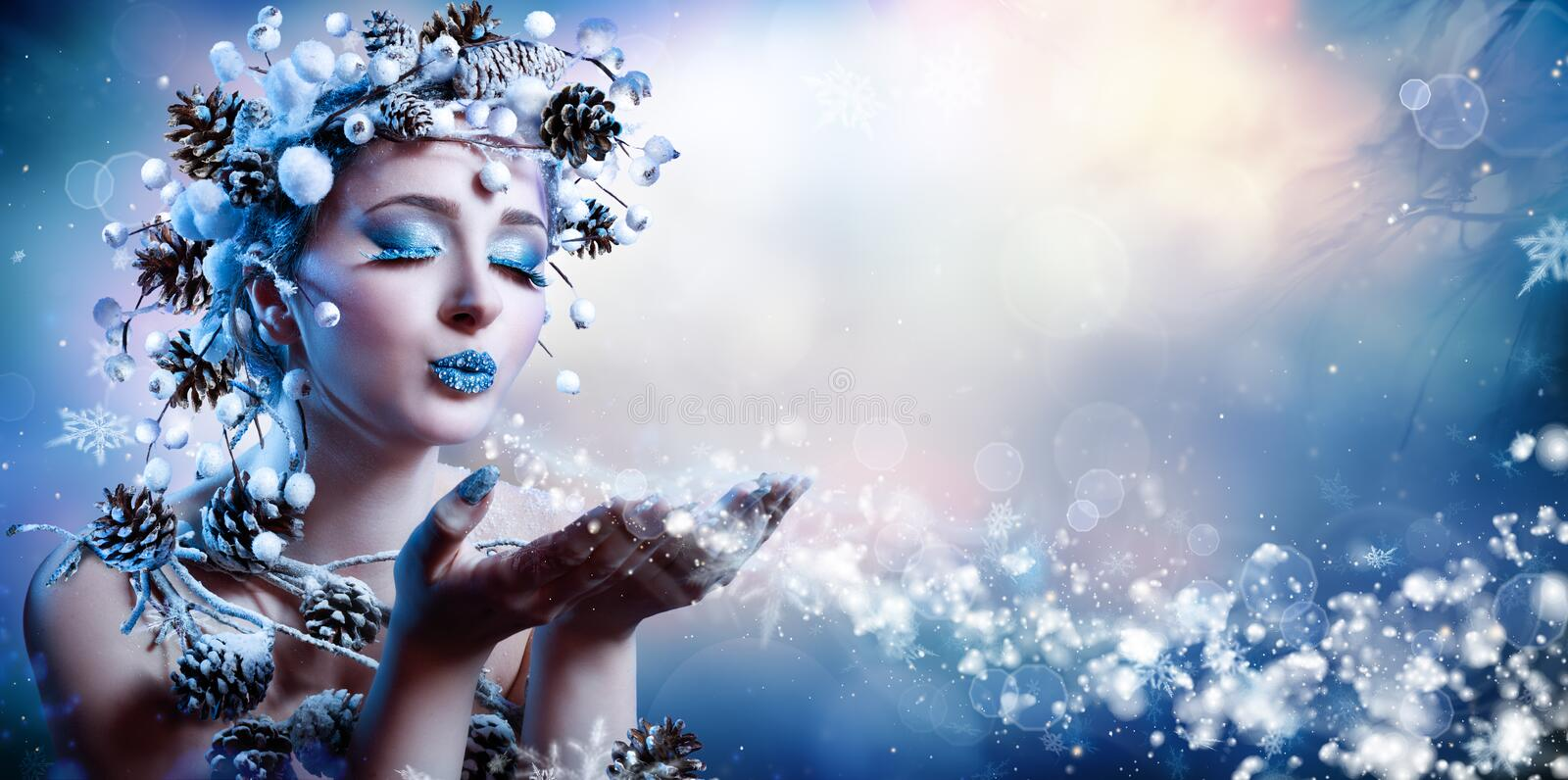 Winter Wish - Model Fashion. Blowing Snowflakes royalty free stock image