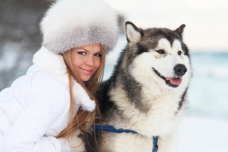 Winter woman with dog. Young woman in winter park with dog royalty free stock images
