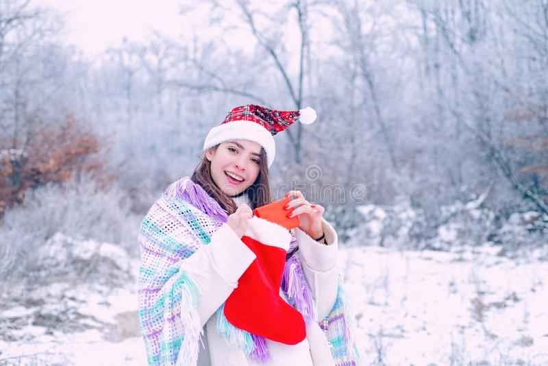 Winter woman. Gift on winter holiday. Girl with present gift in winter park. Suprise in winter day. royalty free stock photo