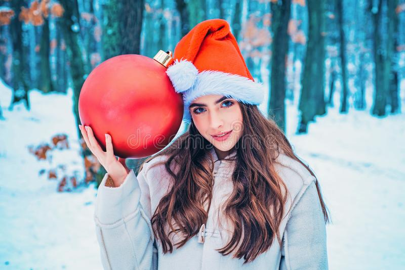 Winter woman happy. Winter portrait of young woman in the winter snowy scenery. What happens during winter season. stock photo