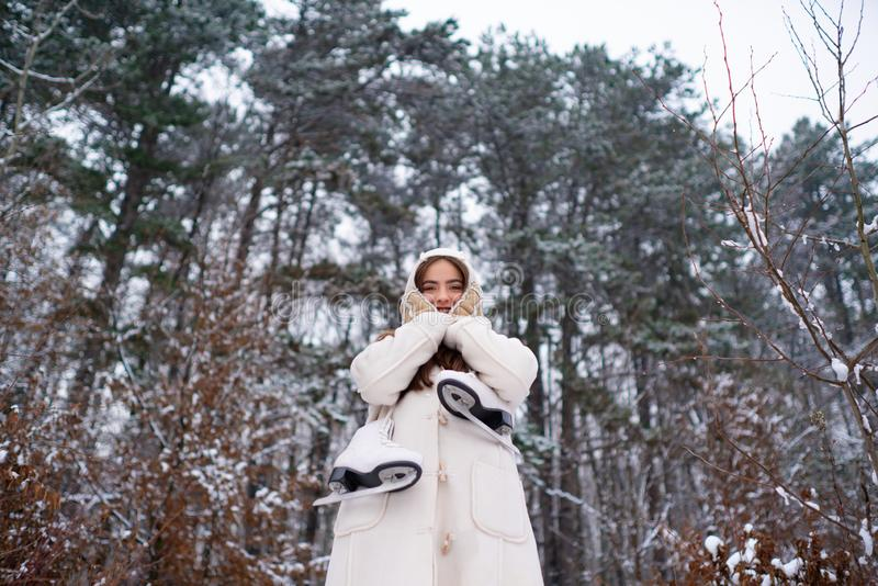 Winter woman snow. Winter woman clothes. Winter portrait of young woman in the winter snowy scenery. royalty free stock photos
