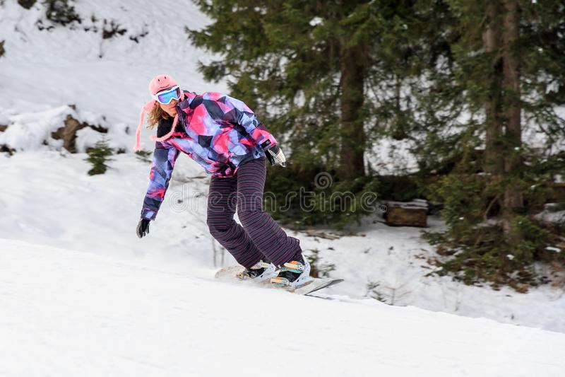 Winter woman snowboarding stock images