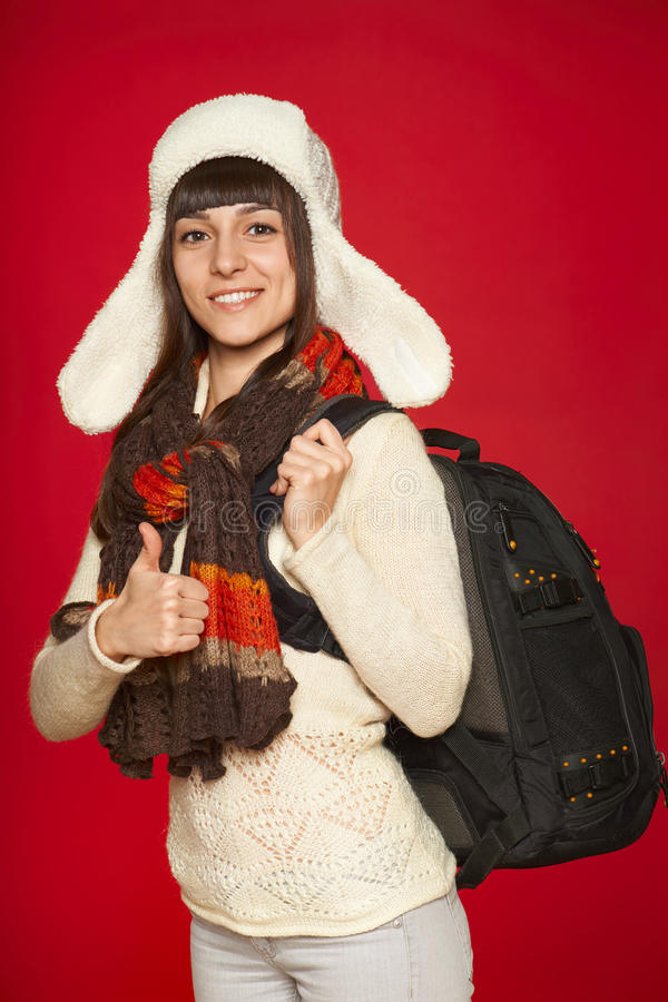 Winter woman tourist with backpack stock images