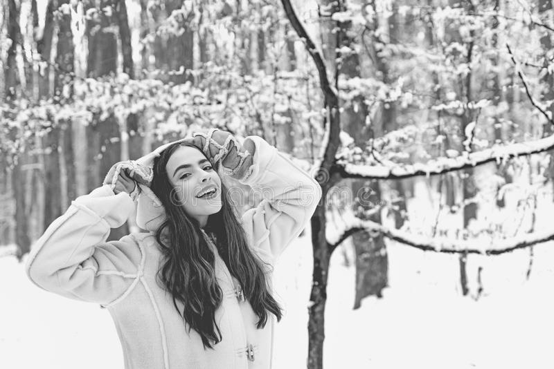 Winter woman wearing stylish sweater and gloves. Joyful Beauty young woman Having Fun in Winter Park. stock images