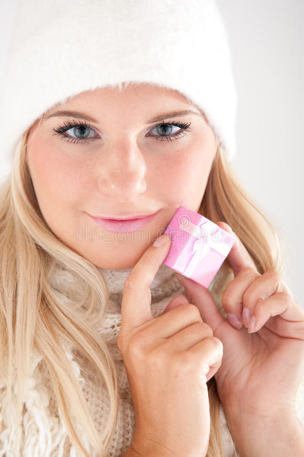 Winter Woman In White Hat Holding Present Stock Photo