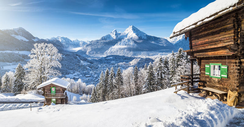 Winter wonderland with mountain chalets in the Alps royalty free stock photography