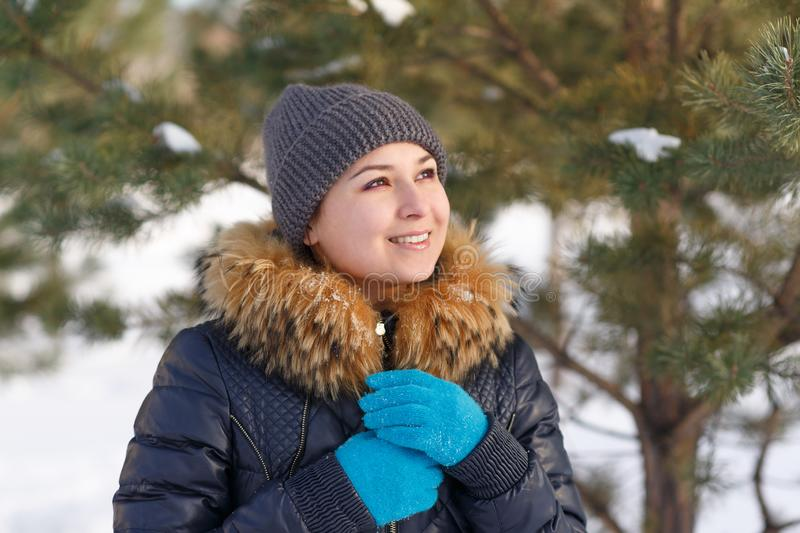 Winter young woman portrait. Beauty Joyful Model Girl laughing and having fun in winter park. Beautiful young female outdoors royalty free stock images