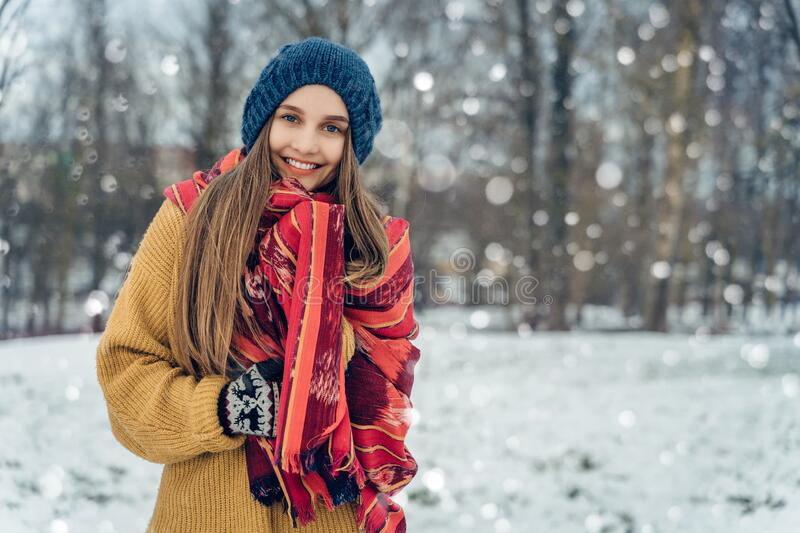Winter young woman portrait. Beauty Joyful Model Girl laughing and having fun in winter park. Beautiful young female stock photos