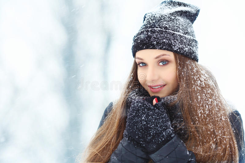 Winter young woman portrait. Beauty Joyful Model Girl laughing and having fun in winter park. Beautiful young woman stock photo