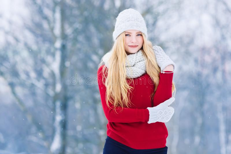 Winter young teen girl portrait. Beauty Joyful Model Girl laughing and having fun in winter park. Beautiful young woman stock image