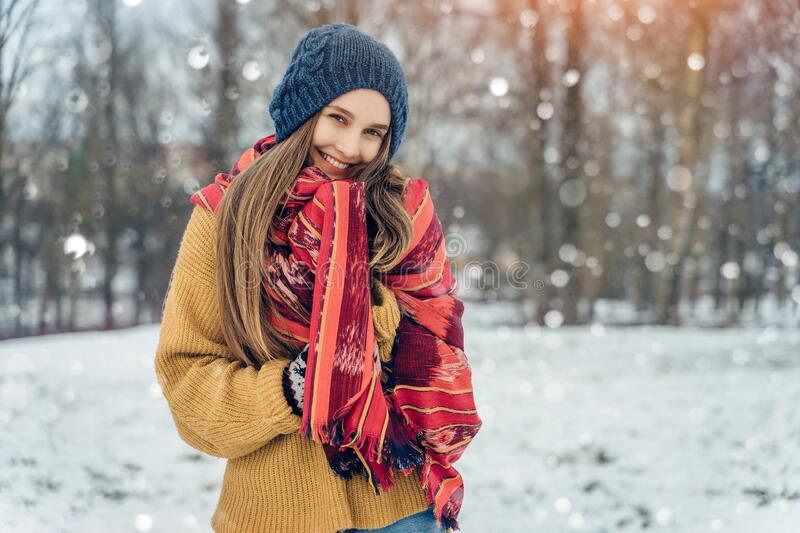 Winter young woman portrait. Beauty Joyful Model Girl laughing and having fun in winter park. Beautiful young female royalty free stock images