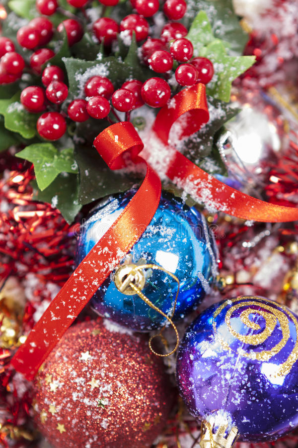 Winterberries and colorful baubles royalty free stock image