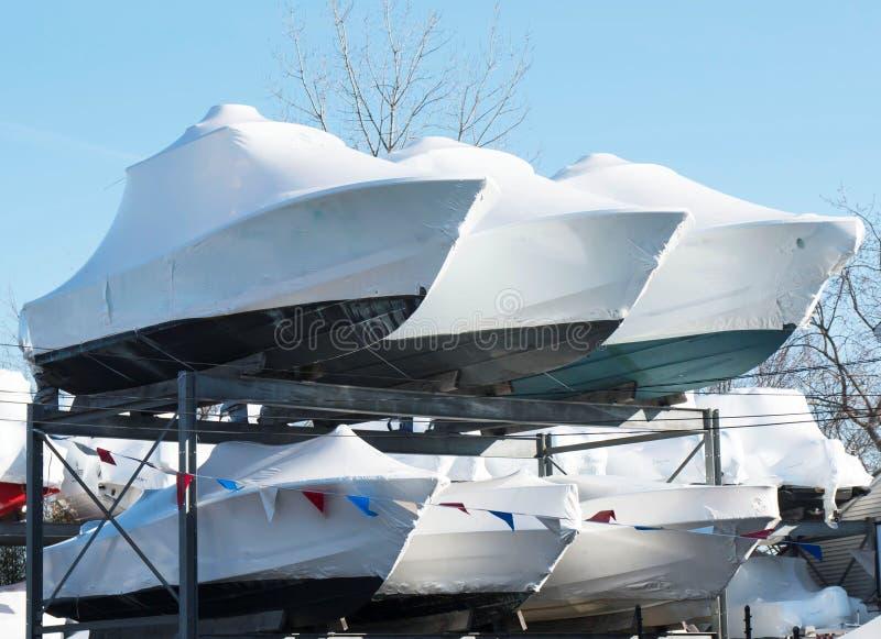 Winterized boats stored on racks stock image