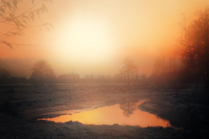 Winterly sunset in a North German moor. Winterly sunset and a landscape covered in hoar frost in a North German moor royalty free stock photo